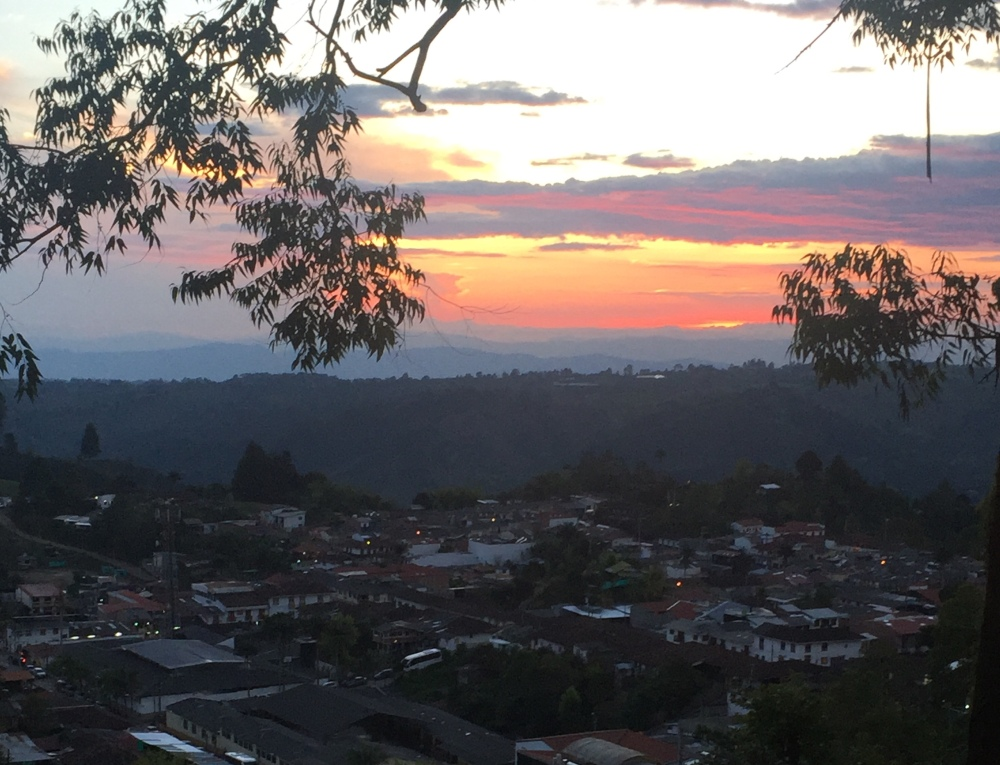 An orange pink and purple sunset over the Andes mountains. Located behind the small town of Salento, Colombia.