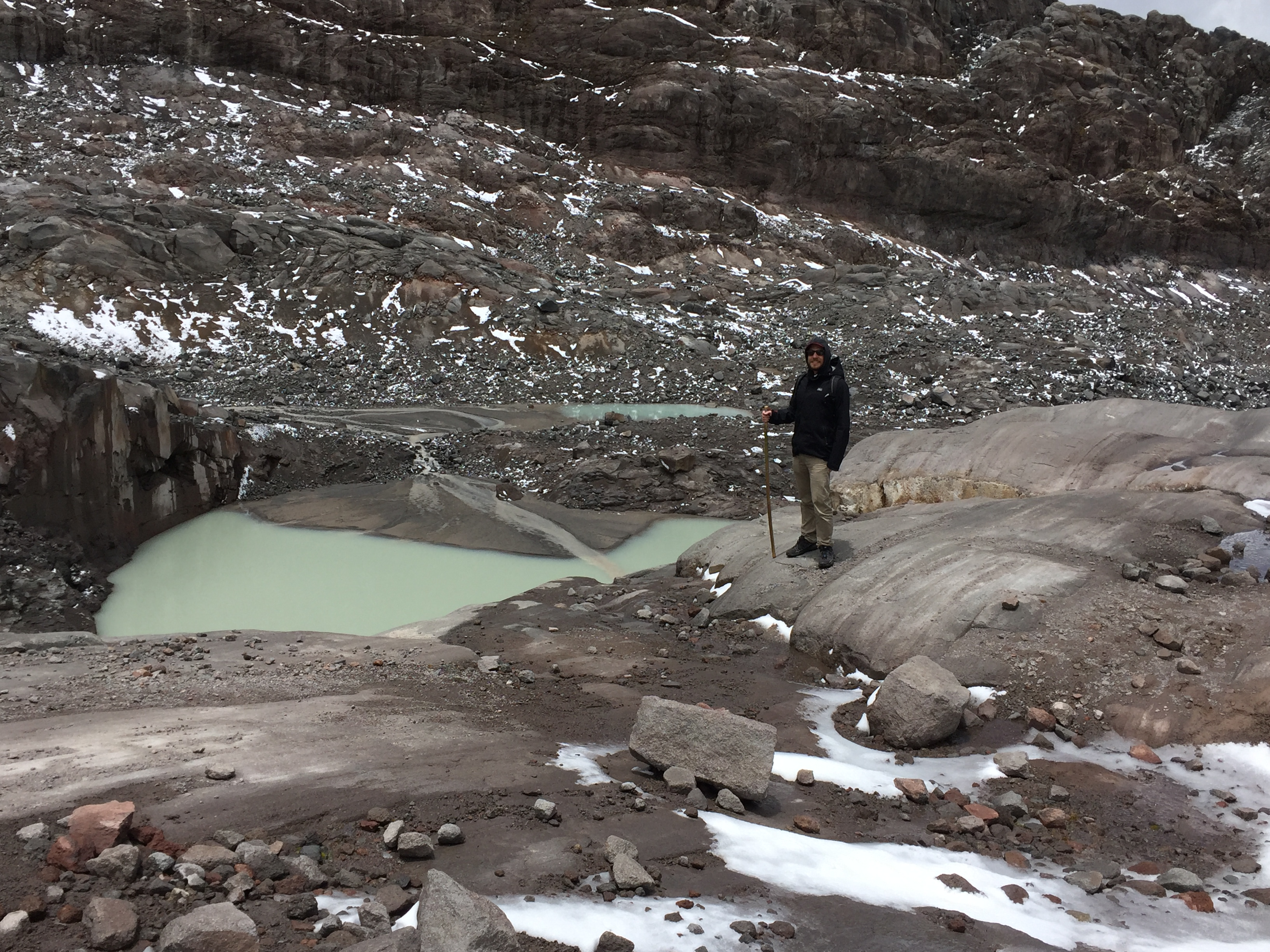 the glacier-fed ponds of the san isabel nevado. They have a strange greenish color, quite distinct from the brown and grey rocks surrounding it.